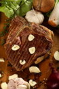 Broiled steak with garlic Royalty Free Stock Photo
