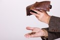 Broke businessman with empty wallet and polish coins brown leather money in male hands business concept problem finance poor Stock Image