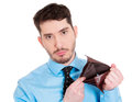 Broke and poor closeup portrait of sad upset unemployed guy fired employee jobless business man holding showing his empty wallet Royalty Free Stock Image