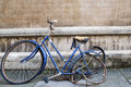 Broken bicycle abandoned out side a college of the university of cambridge england Royalty Free Stock Photography