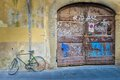 Broken bicycle by old door Royalty Free Stock Image