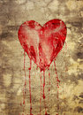 Broken and bleeding heart Stock Image