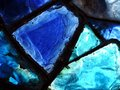 Broken blue stained-glass window. Royalty Free Stock Photo