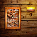 Broken brick wall exposition on wooden wall Royalty Free Stock Photography