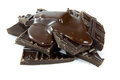 Broken chocolate with melted chocolate Royalty Free Stock Photography