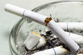 Broken cigarette end with smoking Royalty Free Stock Photo