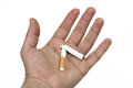 Broken cigarette in hand Royalty Free Stock Photo