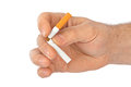 Broken cigarette in hand Royalty Free Stock Photo