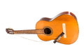 Broken classical guitar with detached bridge isolated in white b Royalty Free Stock Photo