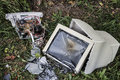 Broken computer on the grass Royalty Free Stock Photo