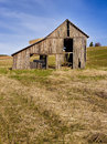 Broken down barn an old run in a field near potlach idaho Stock Images