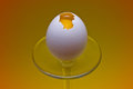 Broken egg a over a cristal platform Royalty Free Stock Photos