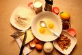 Broken eggs in a dish and the ingredients for the recipe Royalty Free Stock Images