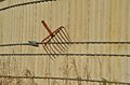 Broken Fork Hanging on an old Silo Royalty Free Stock Photo