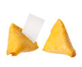 Broken fortune cookie with blank slip isolated Royalty Free Stock Photo