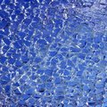 Broken glass cracked over blue background Royalty Free Stock Photo