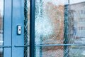 Broken glass front door Royalty Free Stock Photo