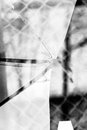 Broken glass grayscale sharp hole cracks splinters by the street background Royalty Free Stock Photos