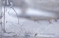 Broken glass window in the winter time with frost on the Royalty Free Stock Images
