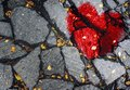 A broken heart on the asphalt. The concept of unhappy love, misunderstanding, sadness, happiness Royalty Free Stock Photo