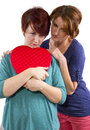 Broken heart consoling a friend suffering from a Royalty Free Stock Photo