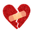 Broken heart glitter ripped heart fixed with adhesive bandage isolated on white Royalty Free Stock Photography