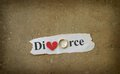 Broken heart paper scrap with divorce text wedding ring and red Royalty Free Stock Image
