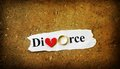Broken heart paper scrap with divorce text wedding ring and red Stock Photos