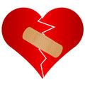 Broken heart with plaster Royalty Free Stock Photos
