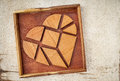 Broken heart tangram pieces in a box a traditional chinese puzzle game made of different wood parts to build abstract figures from Royalty Free Stock Photo