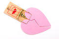 Broken hearted love trap concept photo of pink heart in mouse to illustrate the idea on being trapped in a relationship Stock Images