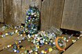 Broken jar of marbles Royalty Free Stock Photo