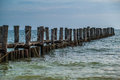 Broken jetty pillars of a proken Royalty Free Stock Images