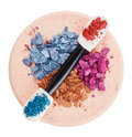 Broken multicolor eyeshadow over makeup sponge Royalty Free Stock Photography