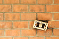 A broken on/off switch on orange brick wall Royalty Free Stock Photo