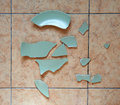 Broken plate on the floor Stock Photo