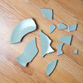 Broken plate on the floor Stock Image