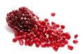 Broken pomegranate segment  on white Royalty Free Stock Image
