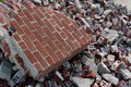 Broken red bricks are piled high at demolition site a Royalty Free Stock Photos