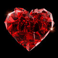 Broken red heart crystal on black background Royalty Free Stock Photos