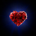 Broken red heart crystal on black background Royalty Free Stock Image