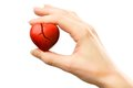 Broken red heart in hand female with Royalty Free Stock Photos