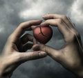 Broken red heart in hands on stormy sky Royalty Free Stock Photos
