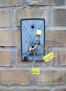 Broken security system with cut wires on a brick background Royalty Free Stock Photo