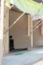 Broken shutters in a street vandals seaside shop Royalty Free Stock Photo