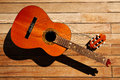 Broken spanish guitar neck on wooden deck Royalty Free Stock Photo