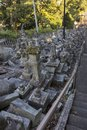 Broken stone lanterns beside the stairs of the Honmyo-ji Temple after the earth quake in 2016