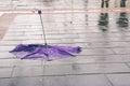 Broken umbrella on wet sidewalk Royalty Free Stock Photo