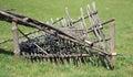 Broken wattle in the green field Stock Image