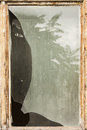 Broken window background texture with wooden frame Stock Photo